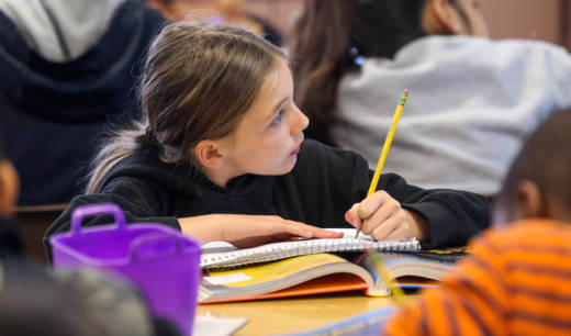 A Greenfield Union student takes notes during class at Kendrick Elementary School in Bakersfield. The district is one of 15 CALmatters studied to understand how well the state's new school funding formula is working.