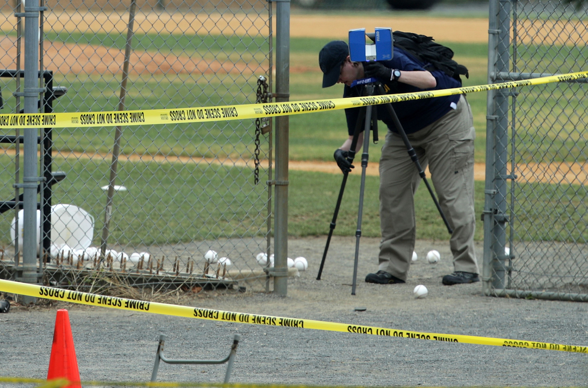 An investigator surveys the site of Wednesday morning's shooting at a GOP congressional baseball practice on June 14, 2017 in Alexandria, Virginia.