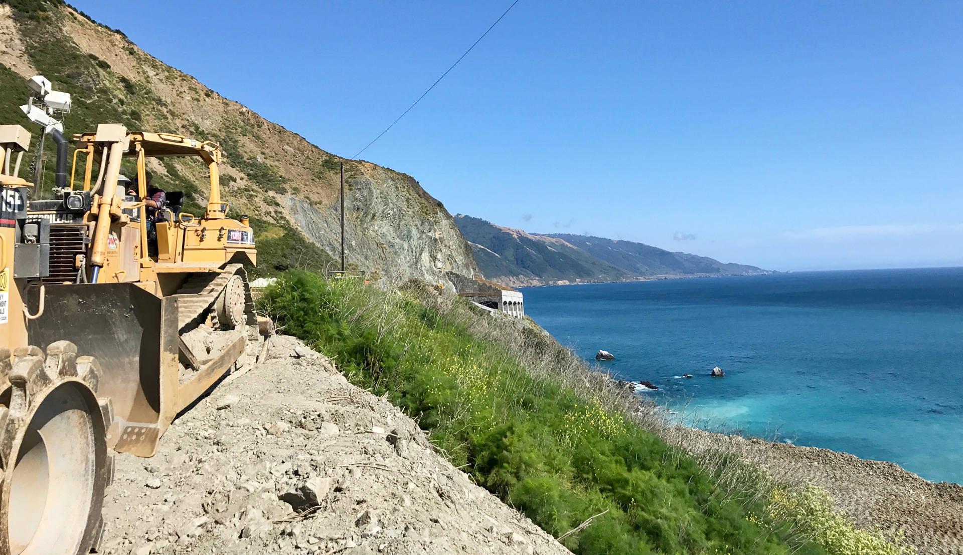 Heavy equipment sits near Paul's Slide on Highway 1. John Sepulvado/KQED
