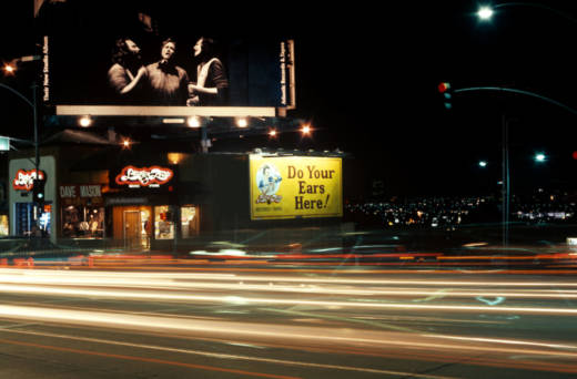 A Crosby Stills and Nash billboard on the Sunset Strip, circa 1977.