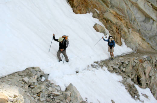 Hikers cross a snow field below Forester Pass on the Pacific Crest Trail.