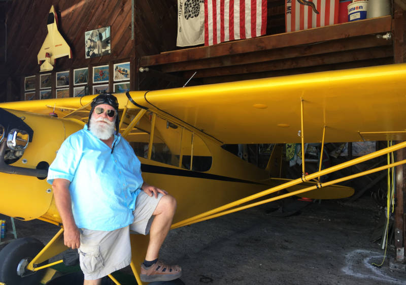Willows resident Greg Michael at the hangar where he stores his 1946 J-3 Cub.