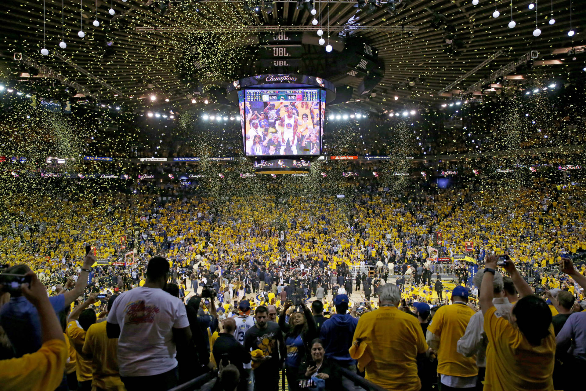 Fans cheer inside Oracle Arena as the Golden State Warriors celebrate their second NBA title in three seasons. Ezra Shaw/Getty Images
