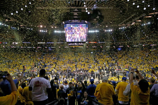 Fans cheer inside Oracle Arena as the Golden State Warriors celebrate their second NBA title in three seasons.