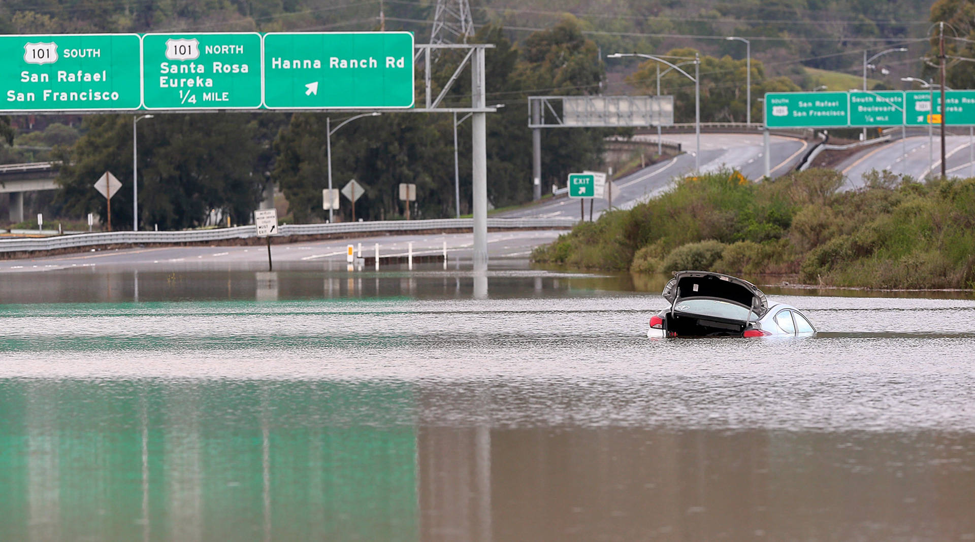 Portions of Highway 37 flood on a regular basis, and the important commuter road is increasingly vulnerable to rising seas. Officials are considering an array of options, including raising the road surface by several feet and protecting it with levees. Christopher Chung/The Press Democrat