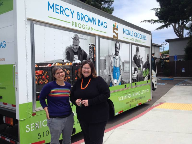 (l-r) Mercy Brown Bag Program's Assistant Director Nicole St. Lawrence and Director Krista Lucchesi after supplying free groceries to seniors in Hayward with the truck.