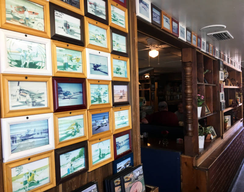 'Some people hang hats on the wall, we hang people's pictures with their airplanes on the wall,' says Nancy's waitress Tricia Lawson.