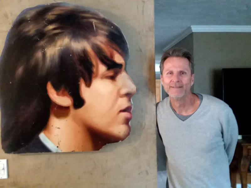 Robert Quinn with Paul McCartney's head, which was cut off from the 'Abbey Road' billboard.