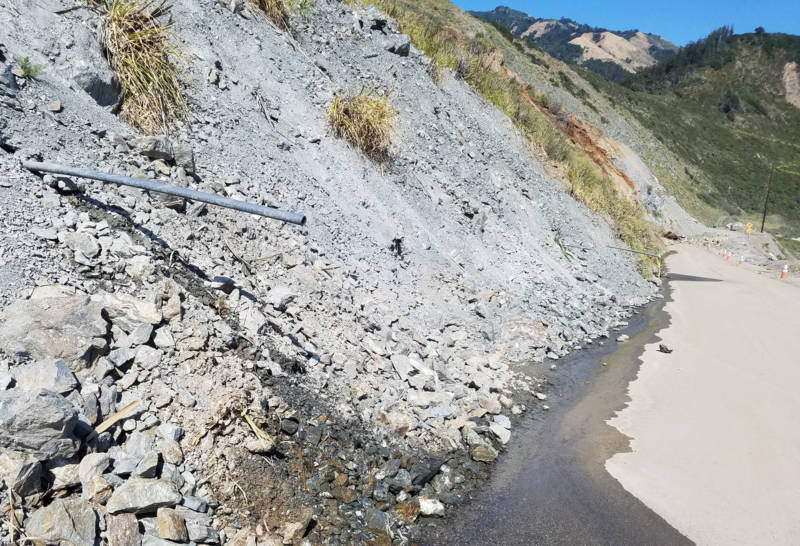 Water drains off Paul's Slide onto what exposed surface remains of Highway 1.