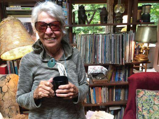 Penny Vierrege standing in front of her record collection at her home in Big Sur. Vierrege attended all three days of the original Monterey International Pop Festival in 1967.