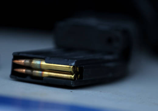 A surrendered assault rifle magazine with bullets sits on a table during a gun buyback event on December 17, 2016 in San Francisco.