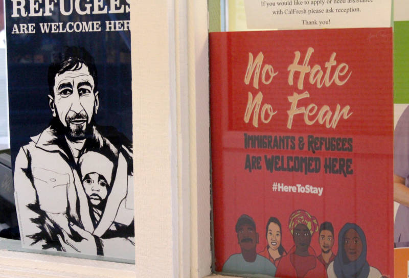 The offices at Catholic Charities of the East Bay display posters welcoming refugees.