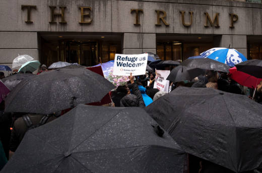 Protesters rally in front of the Trump Building on Wall Street in response to the Trump administration's proposed travel ban and refugee policies on March 28, 2017.