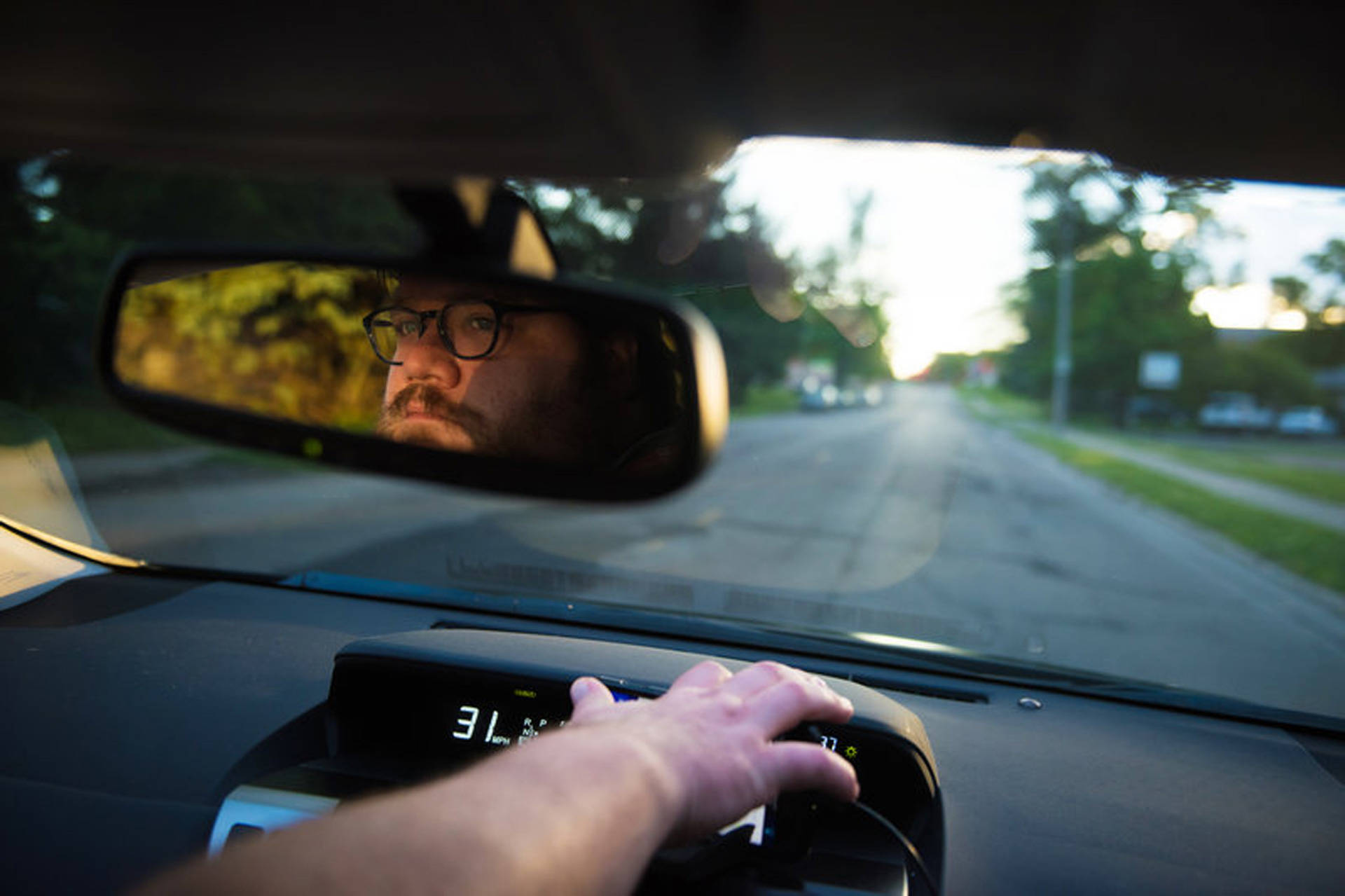 Kyle Reninger drives for Uber part time, typically on weekend nights, so he is more likely to pick up surge prices, which earn him more money. He also drives for Lyft, an Uber competitor. Lucas Carter for NPR