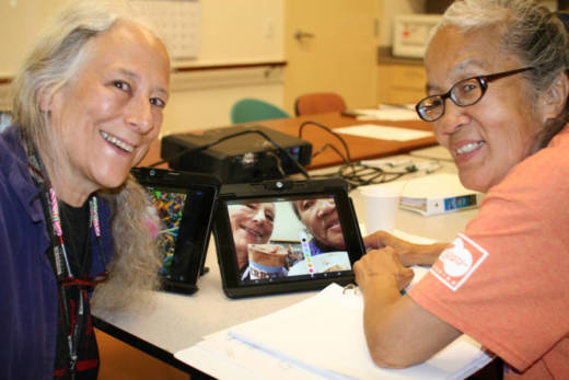 Shirley Smith and Marilyn Chan edit their ice cream store selfie. They are part of a program that teaches seniors who live alone to use tech tools that could help reduce isolation and loneliness.