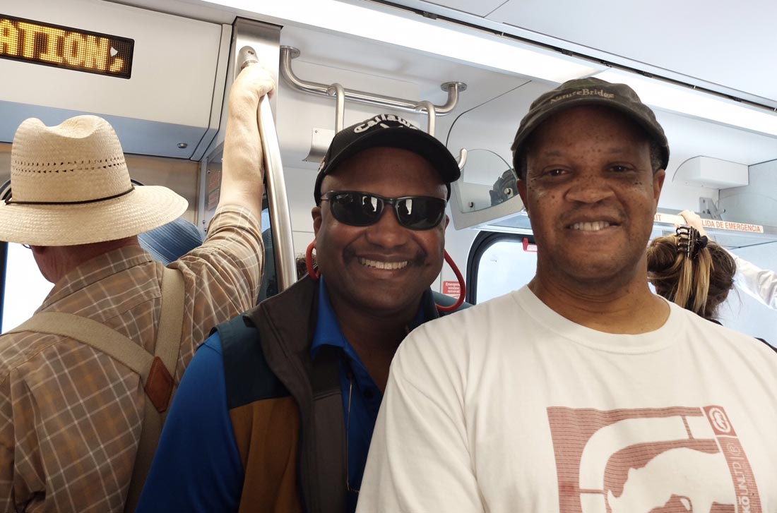 Curtis Finley and Tony Brown (L–R) ride the SMART Train on a preview ride, June 29, 2017.