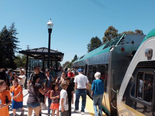 Passengers depart at the Rohnert Park station during a preview ride for the SMART Train, June 29, 2017.