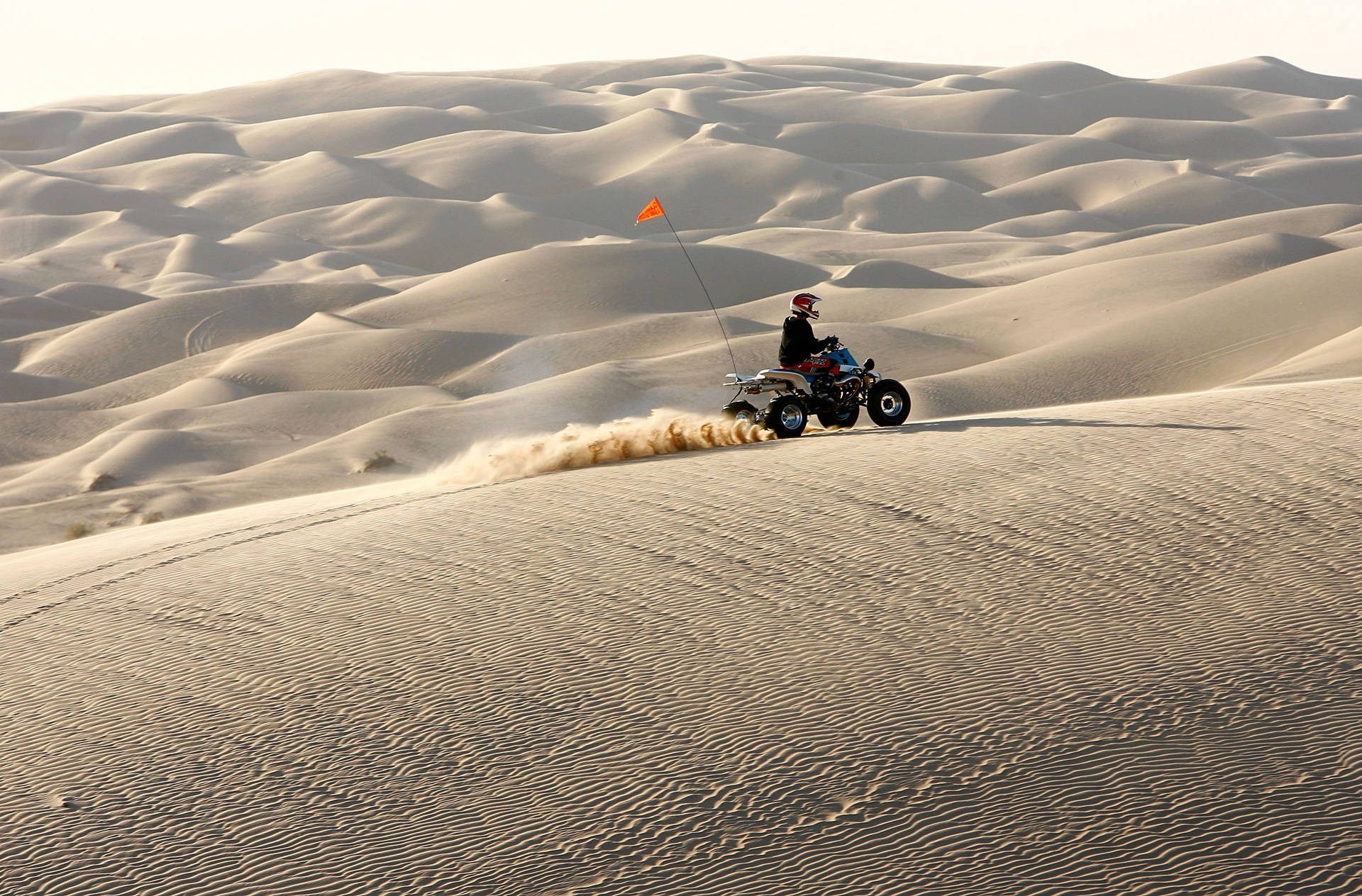 An ATV driver rides in the Colorado Desert at the Imperial Sand Dunes, also known as the Algodones Dunes. Imperial County firefighters and police officers patrol the area, and are partially compensated through the federal PILT program, which President Trump's budget would slash. David McNew/Getty Images