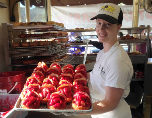 Katelyn Johnson displays The Donut Man's calling card: the strawberry donut.