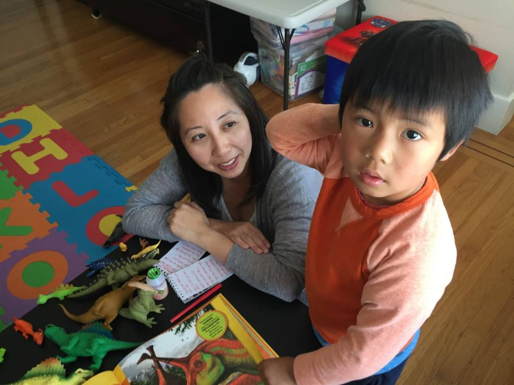 Kolten Wong, a five-year-old dinosaur aficionado seen here at home in Daly City with his mom, Annie, wanted to know what dinosaurs used to roam the Bay Area.