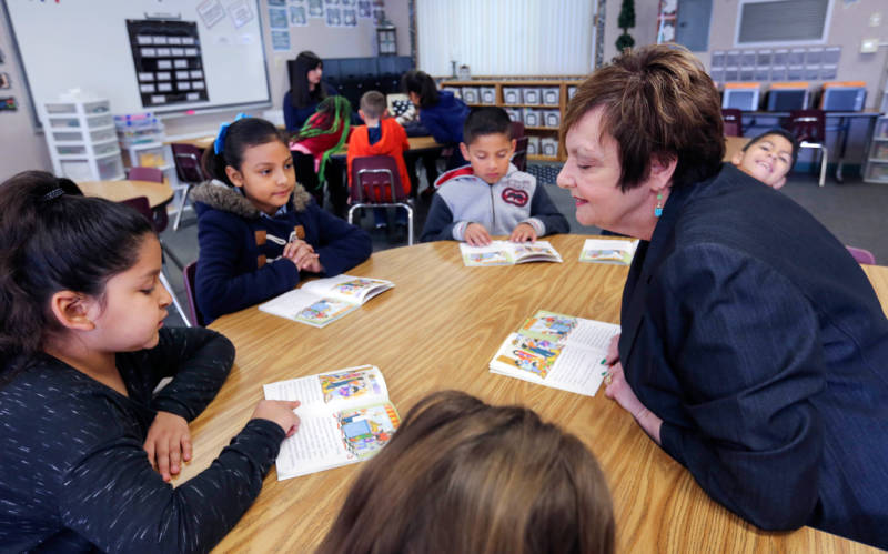 Teacher Dennise Carter works with a small group of students at Kendrick Elementary School in Bakersfield's Greenfield Union School District. The district used some of the money it received for needy students under the state's new school funding system to hire veteran teachers like Carter as academic coaches.