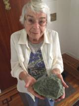 Doris Sloan, a retired geologist seen here holding a sample of serpentinite at her home in Berkeley, says during the time of the dinosaurs, the Bay Area was thousands of feet underwater.