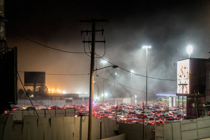 Cars wait in line to cross from Mexico into the United States on May 2 in Tijuana. The U.S. government says approximately 50,000 vehicles cross between Tijuana and San Diego every day.
