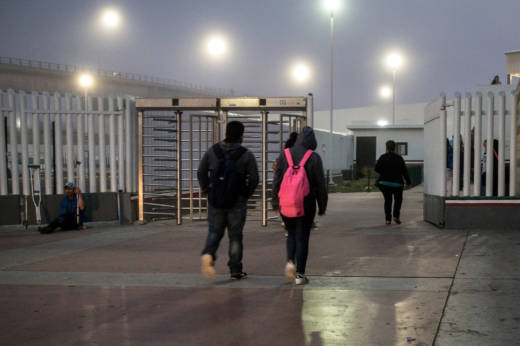 Students in Tijuana walk toward the U.S. border early in the morning. Teachers in San Diego estimate that about 1,000 students cross from Tijuana into San Diego every day to go to school.