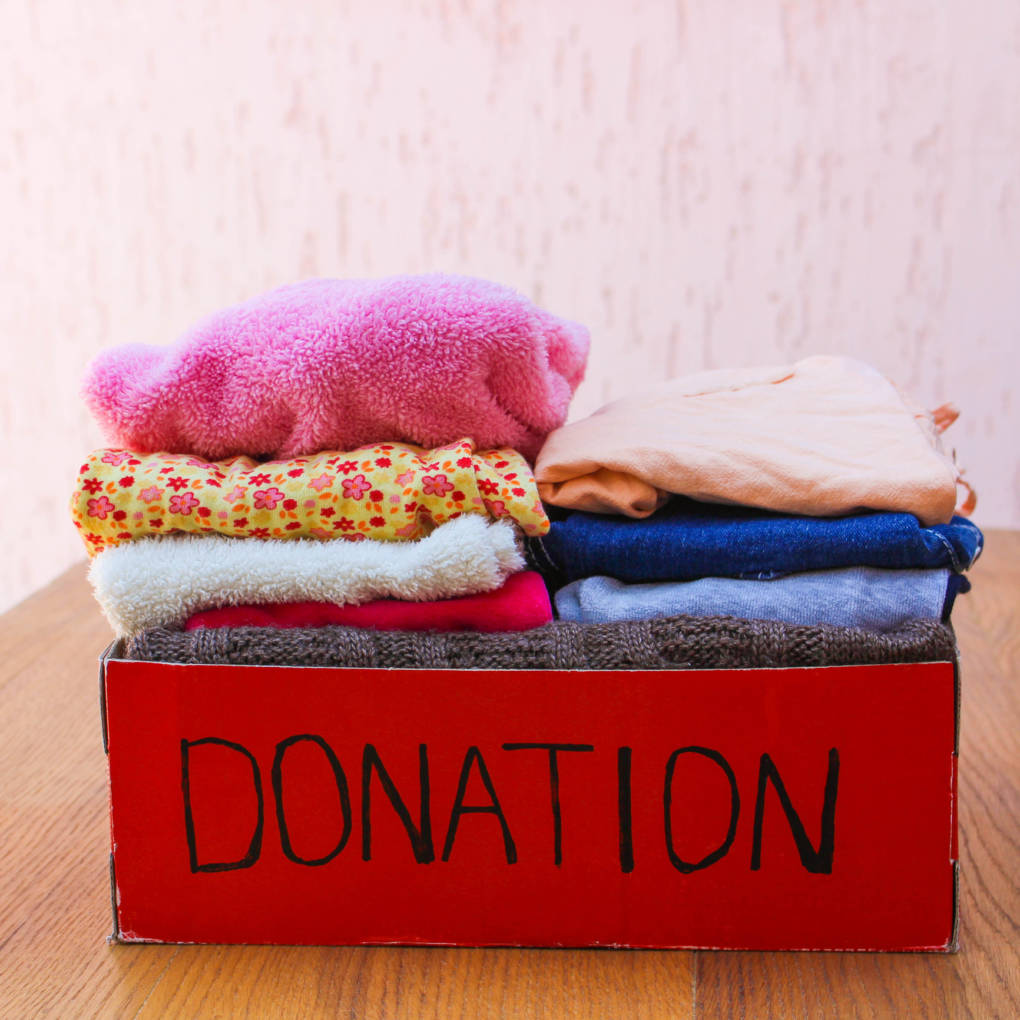 There a number of organizations that will take used clothing, and recycle anything not fit for reuse.