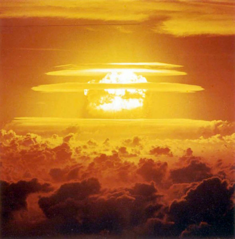 This is an archival photo of Castle Bravo, 3.5 seconds after detonation. at a a distance of 75 nautical miles from ground zero. This bomb was the largest and dirtiest bomb ever detonated by the U.S. It was so large you can still see the crater from space.