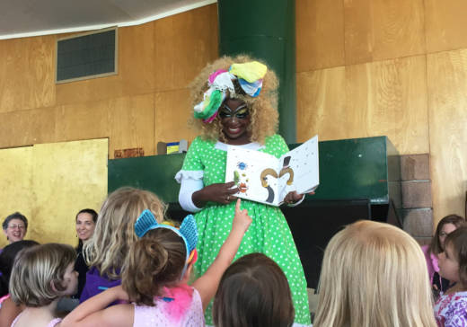 Black Benatar reads aloud to children at Dimond Recreation Center in Oakland as part of Drag Queen Story Hour.
