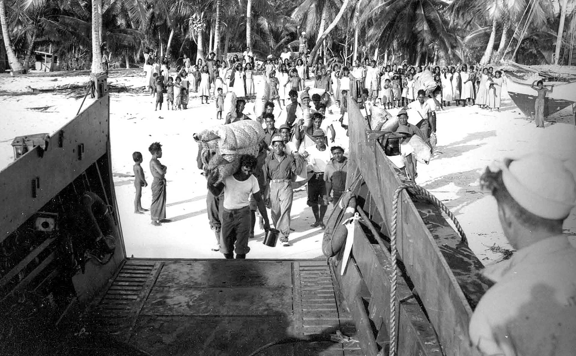 Marshallese evacuate from their island of Bikini in 1946, in advance of nuclear weapons testing. National Security Archives