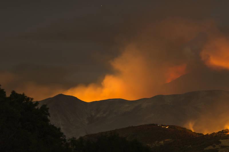 The Whittier Fire burns through the night on July 9, 2017 near Santa Barbara.