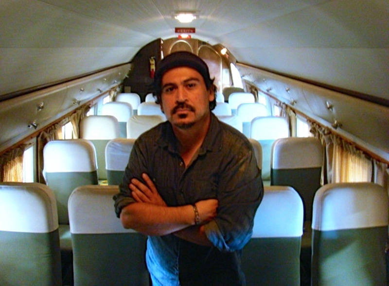 Author Tim Z. Hernandez inside a Douglas DC-3 airplane, similar to the one that crashed in 1948.