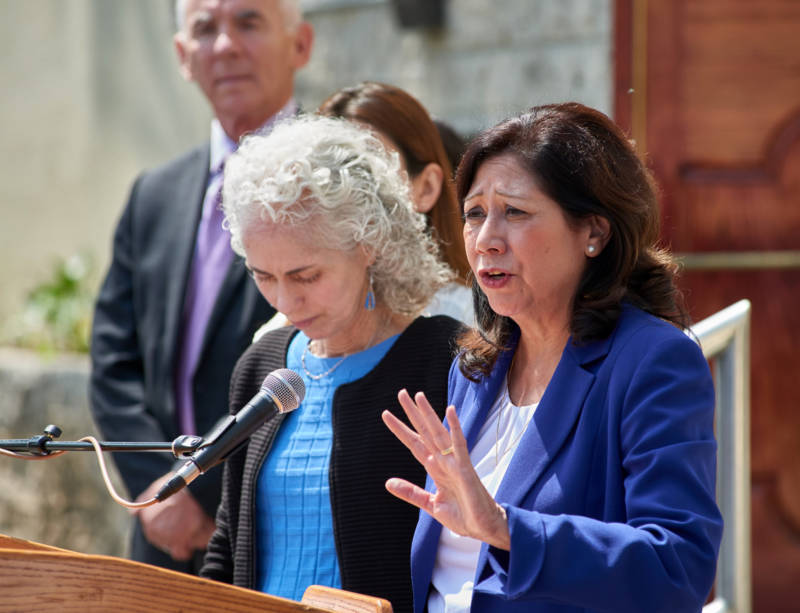Los Angeles County Supervisor Hilda Solis (R) called on state officials to work faster on cleaning up homes contaminated by lead dust from the Exide battery recycling plant at a press conference in June.