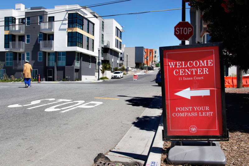 A welcome sign stands outside the new Shipyard housing development at Hunters Point.