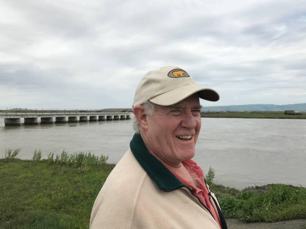 Bay Curious listener John Aird. Behind him is the bridge leading to Drawbridge.