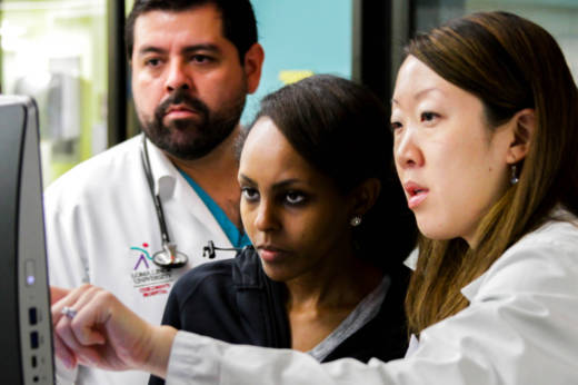 Doctors Rudy Silva and Lily Assefa work with pediatric pharmacist Nancy Chang at the Loma Linda University Medical Center.