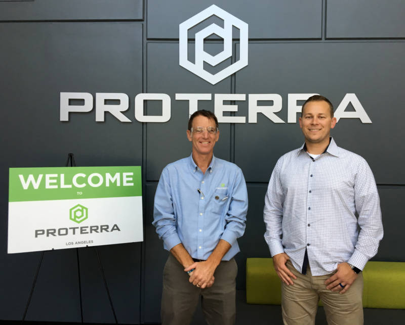 Paul Mottram (L), plant manager, and T.J. Nass, customer program manager at Proterra's City of Industry facility.