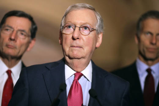 Senate Majority Leader Mitch McConnell (R-KY) (C) talks to reporters with Sen. John Barrosso (R-WY) (L) and Sen. John Thune (R-SD) following their party's weekly policy luncheon at the U.S. Capitol May 16, 2017 in Washington, DC. McConnell released a statement promising to repeal Obamacare after the GOP could not get enough support to pass their health care bill.