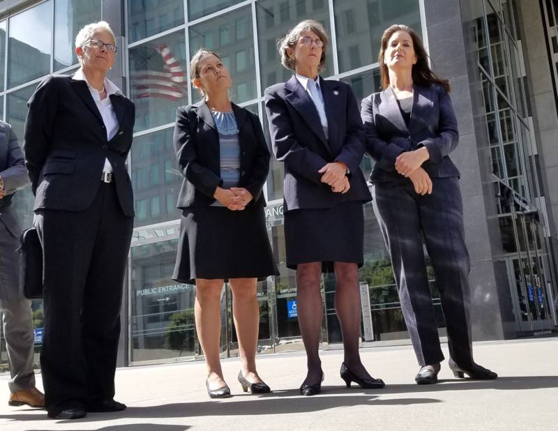 From left, Oakland Police Department spokeswoman Officer Johnna Watson, City Administrator Sabrina Landreth, Police Chief Anne Kirkpatrick and Mayor Libby Schaaf gather outside federal court in San Francisco on July 10, 2017.