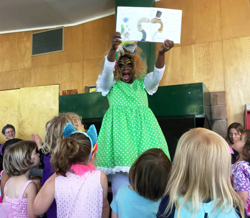 Black Benatar reads to children at Drag Queen Story Hour in Oakland.