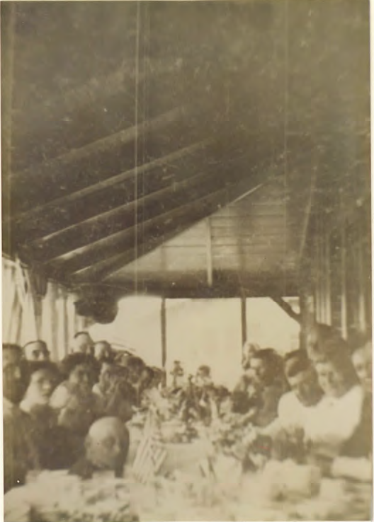 Dining inside the front porch at the Sprung Hotel. Mrs. Sprung second from right.
