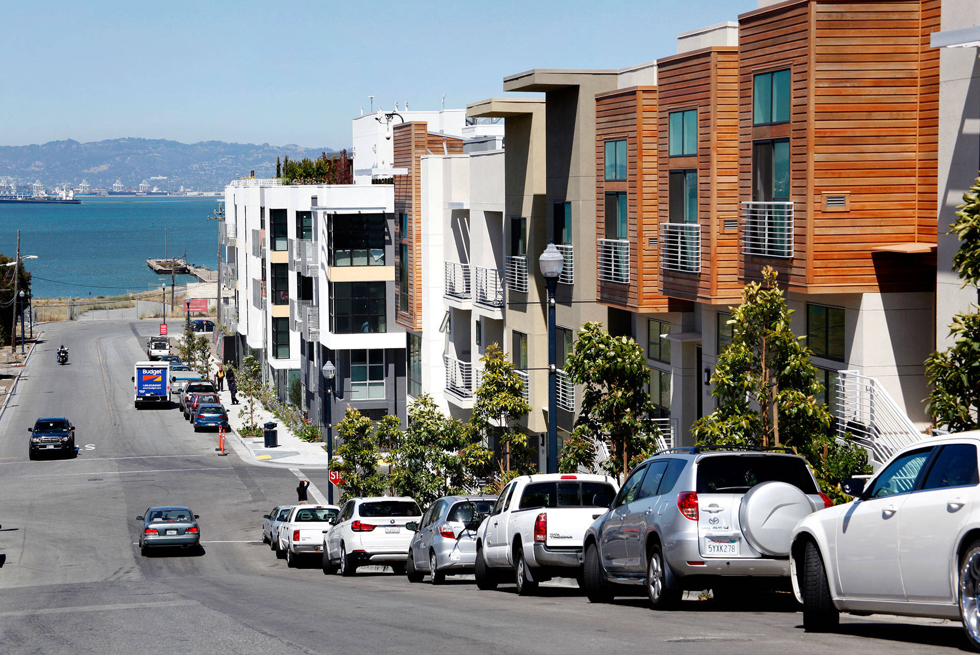 Several finished apartment buildings in Lennar's San Francisco Shipyard development look out over the bay in Hunters Point. Brittany Hosea-Small/KQED