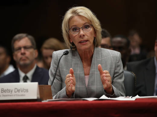 Education Secretary Betsy DeVos is accused of unlawfully delaying a federal rule created to protect students from the fallout from abuses and failures by for-profit colleges.