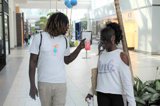 Maya Terrell (R) walks with Lamarr Morris in Sacramento's Arden Fair Mall on June 19.