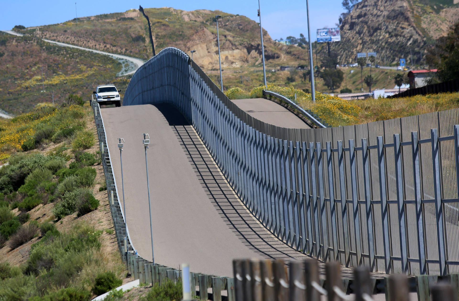 Border Patrol agents patrol the U.S.-Mexico border near San Ysidro on Sunday, April 16, 2017. SANDY HUFFAKER/AFP/Getty Images
