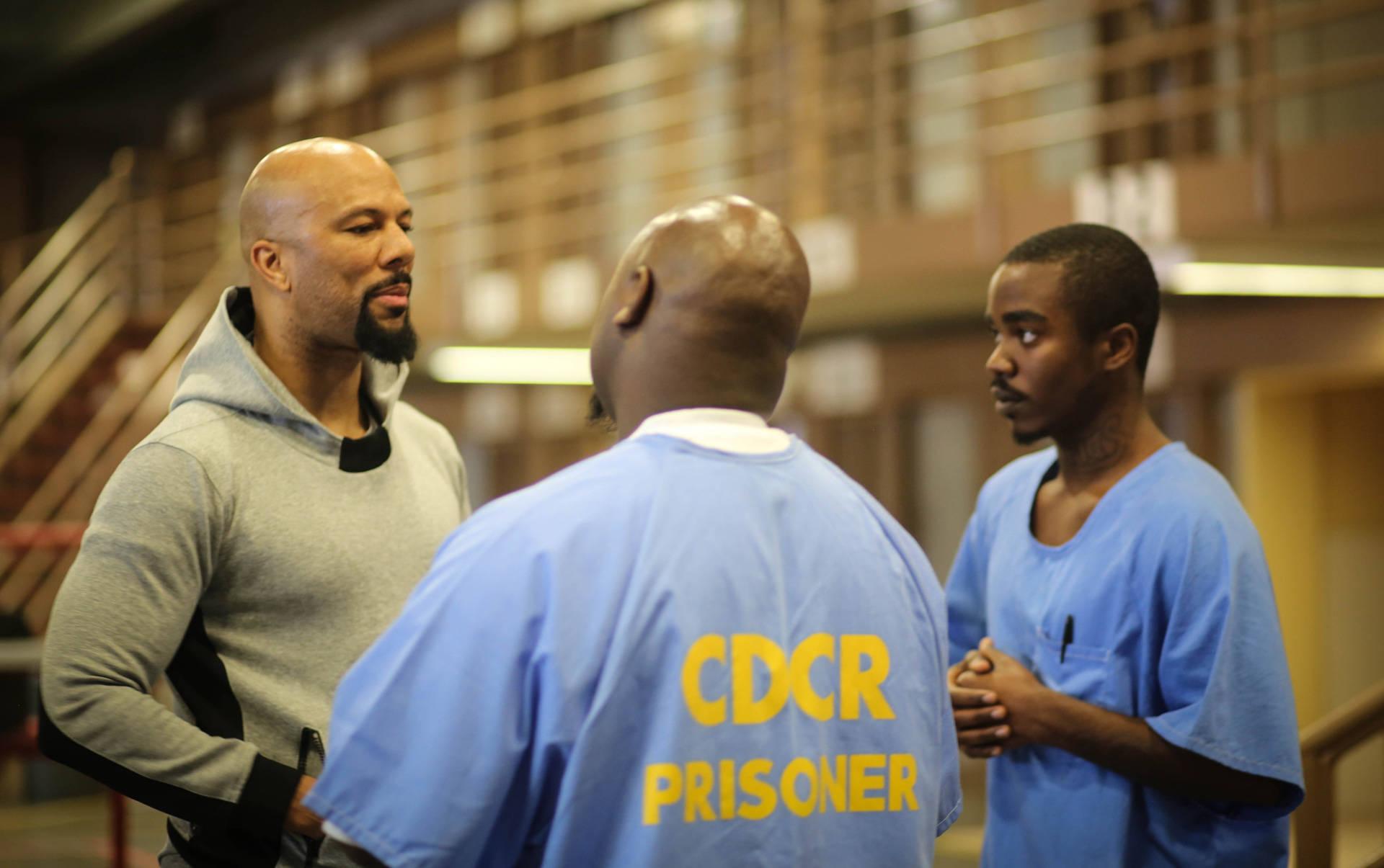 Hip-hop artist Common meets with inmates at a California prison.  Sade C. Joseph