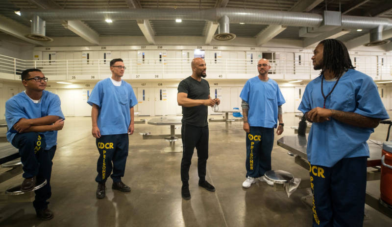 Common meets with inmates at a California prison.
