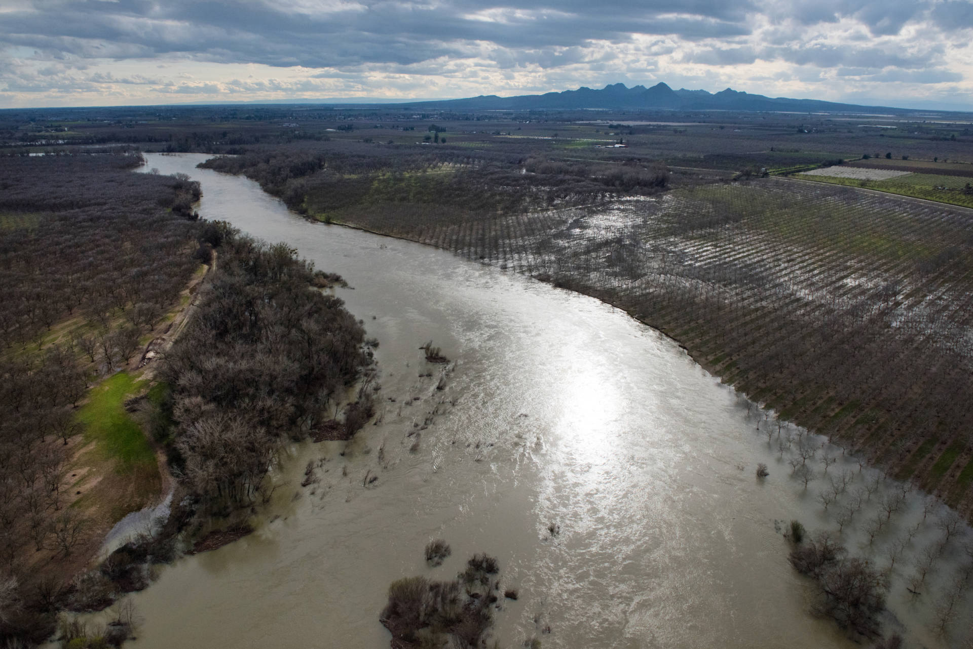 An aerial view looking at the Feather River downstream from Oroville the day before the Department of Water Resources dramatically reduced flows in late February 2017. Kelly M. Grow/California Department of Water Resources